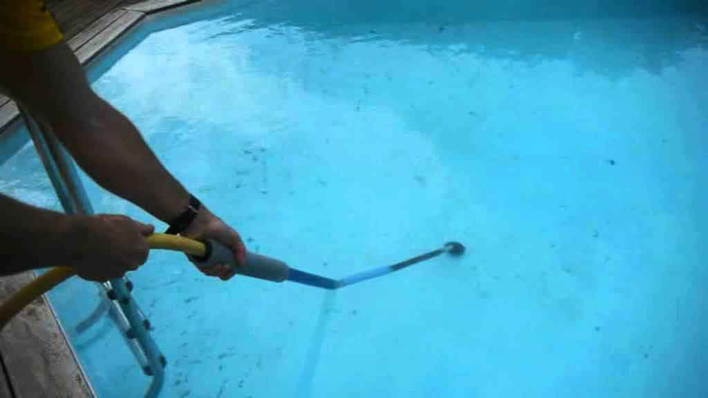 remove dirt from the bottom of the pool